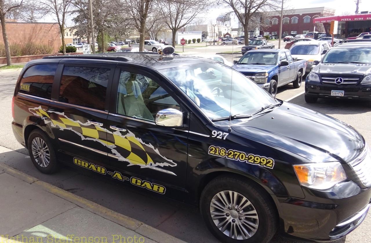 black grab-a-cab Taxi (right)