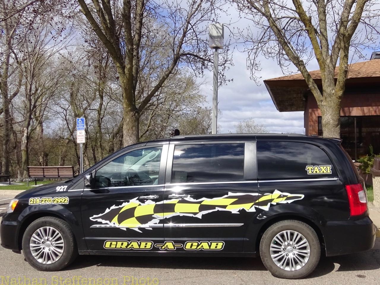 black grab-a-cab Taxi (left)