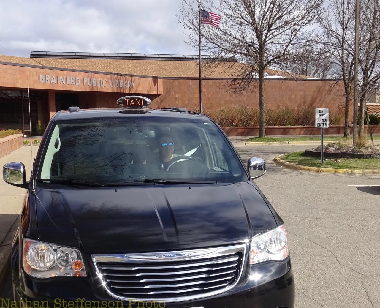 black grab-a-cab Taxi (front)