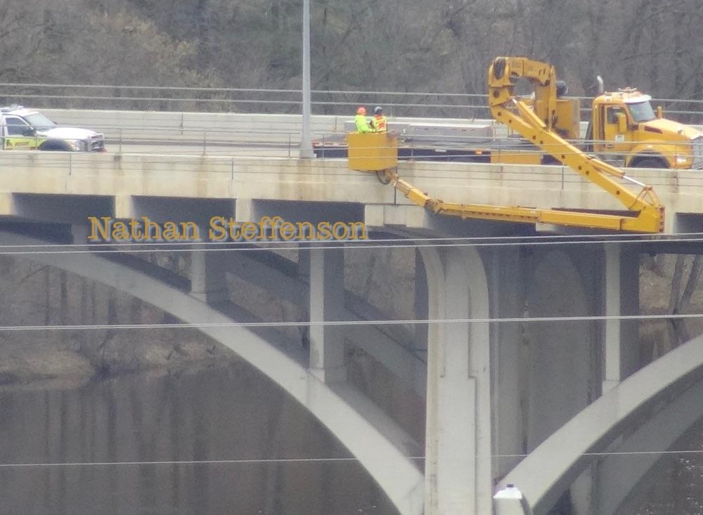 Washington street bridge inspection person on yellow boom truck